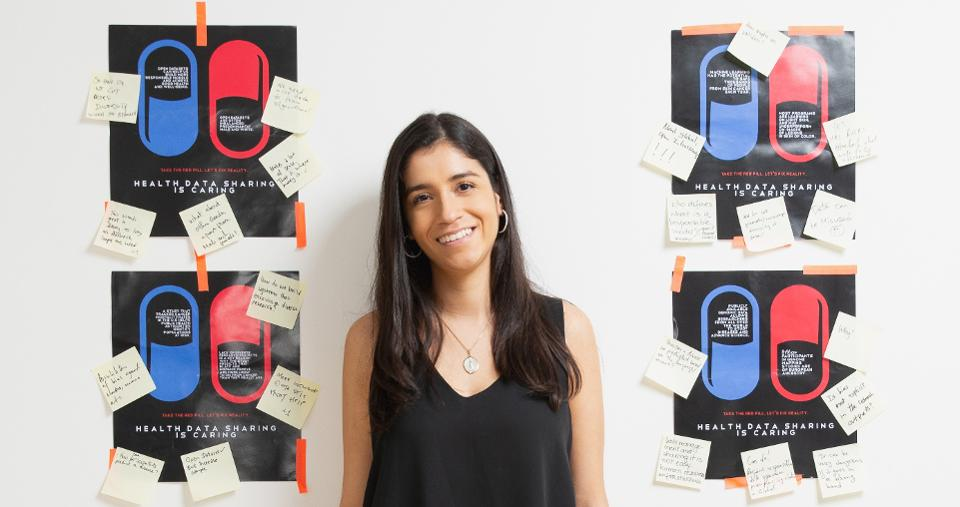Natalia Norori, with posters created for the Health Data Sharing is Caring Project