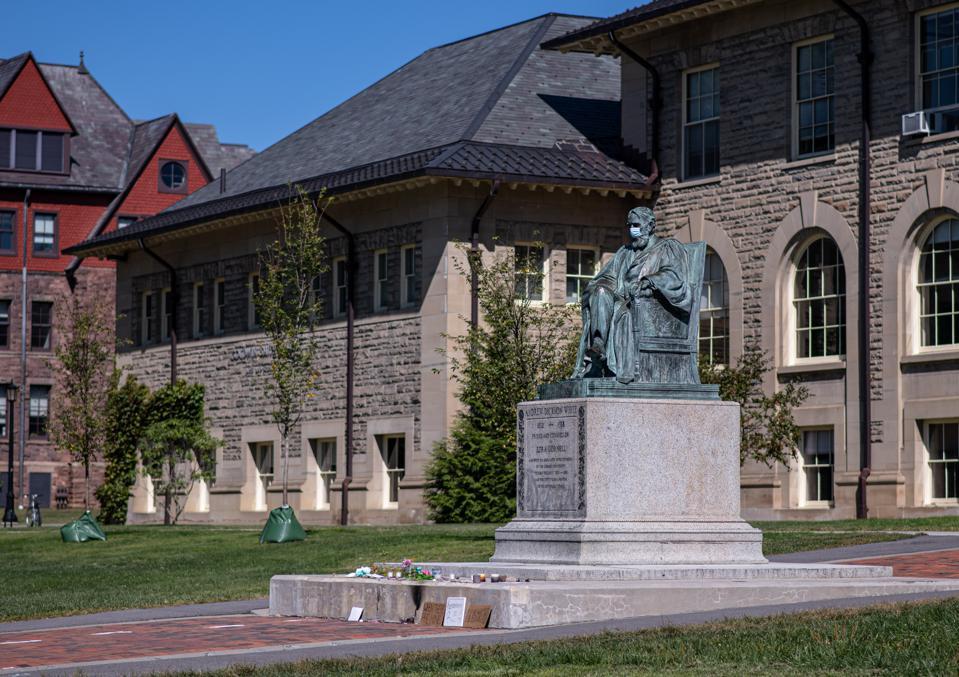 Statue of Ezra Cornell, masked. Cornell University