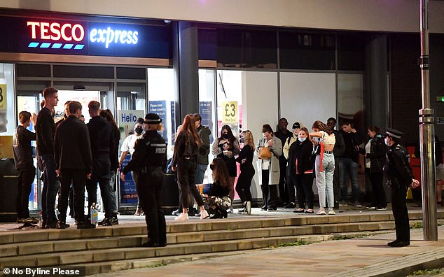 PORTSMOUTH: Supermarkets were crowded across the country after the 10pm curfew, including this Tesco Express store on Saturday