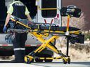 A paramedic returns a stretcher to his ambulance at Toronto Western Hospital during the ongoing Covid 19 pandemic, Wednesday April 1, 2020.