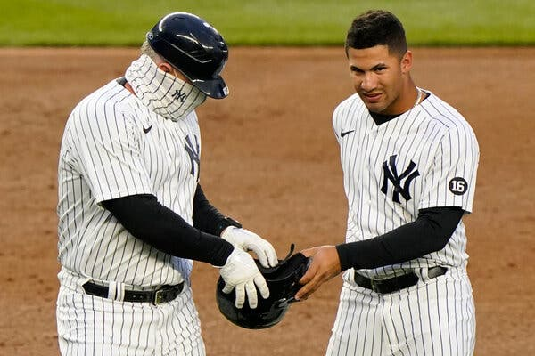 Gleyber Torres, right,a second baseman, Phil Nevin, a third-base coach, and seven others with the Yankees baseball team tested positive for the coronavirus this month after vaccinations.
